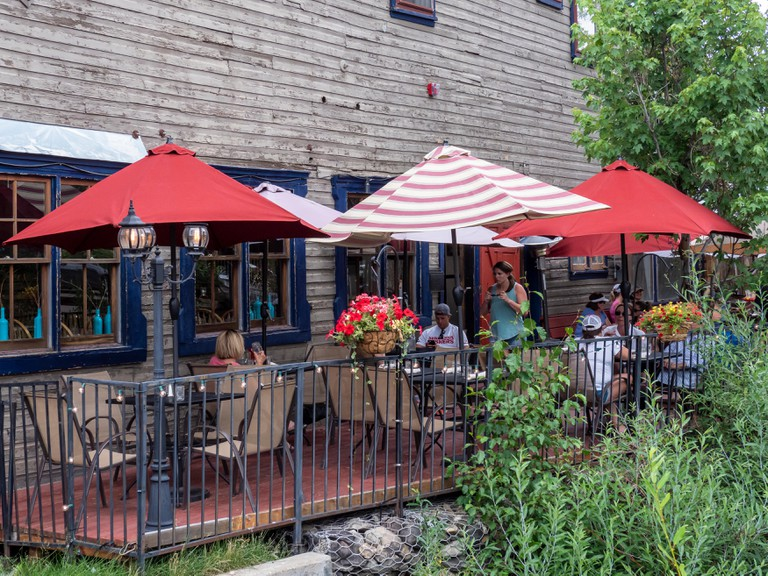 Al fresco diners enjoying lunch at the Forest Queen Hotel, Coal Creek Grill, Crested Butte, Colorado