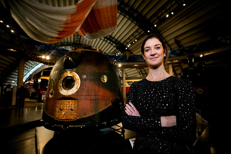 Dr. Norah Patten stands beside British astronaut Tim Peake's Soyuz TMA-19M capsule at the Ulster Folk and Transport Museum in Cultra