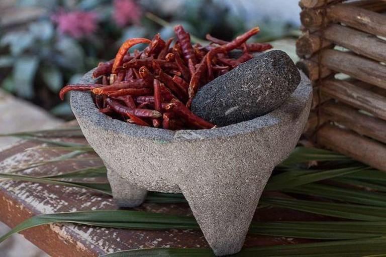 Chili, mortar and pestle