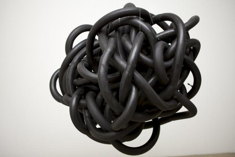 The Propeller Group, Chasing Inertia, 2012, 150 x 150 x 150 cm, approximately fifty black tire inner tubes [sized 2I25/2.50 – 17] | Courtesy Galerie Quynh & Artists