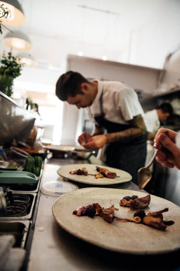 Chef Ari Taymor Plating at Alma / Courtesy of Lauren Edward Photography