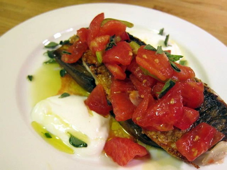 A fish steak on a bed of aubergine carpaccio at Yudaleh