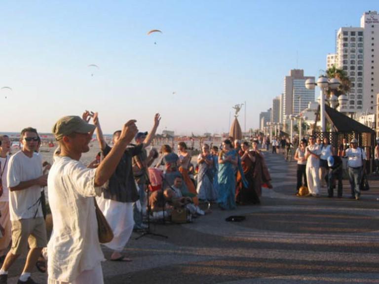 Hare Krishna dance and sing along the beach promenade