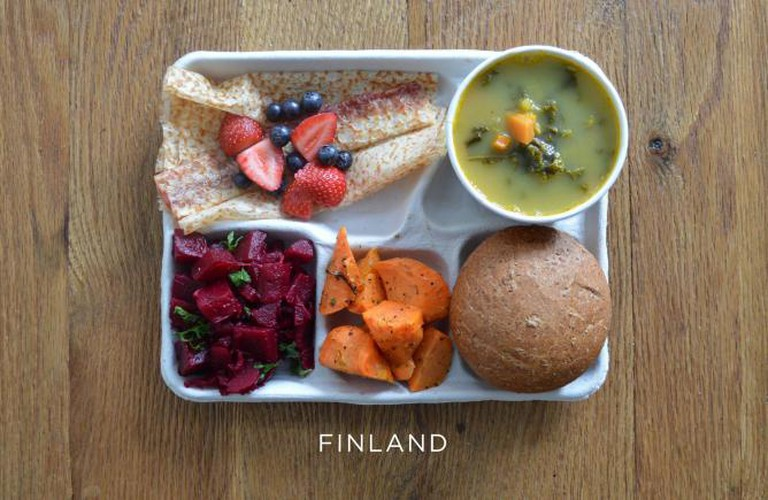 Pea soup, beet salad, carrot salad, bread and pannakkau (dessert pancake) with fresh berries