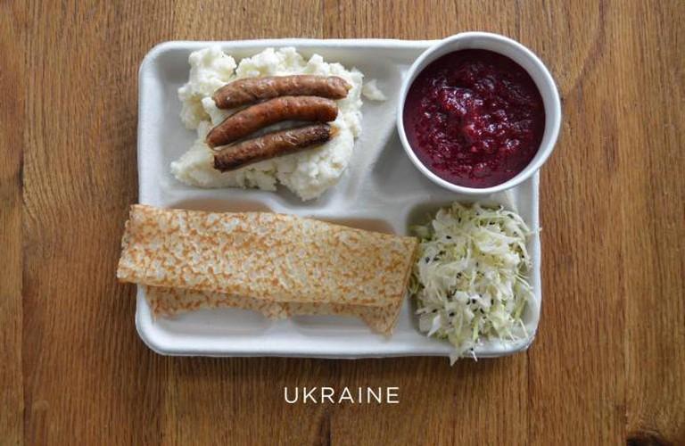 Mashed potatoes with sausage, borscht, cabbage and syrniki (a dessert pancake)