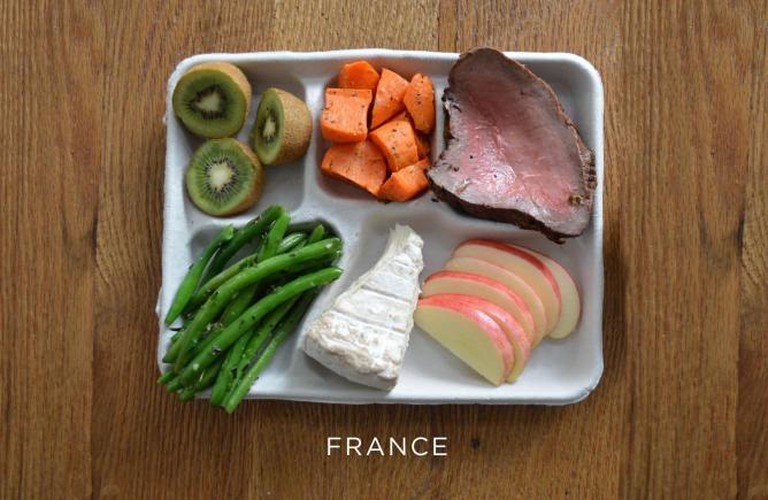 Steak, carrots, green beans, cheese and fresh fruit