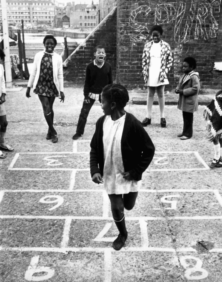 'Children playing hopscotch at a community centre run by the Make Children Happy charity near St Katherine's Dock, East London, 23 November 1972' – Getty Images