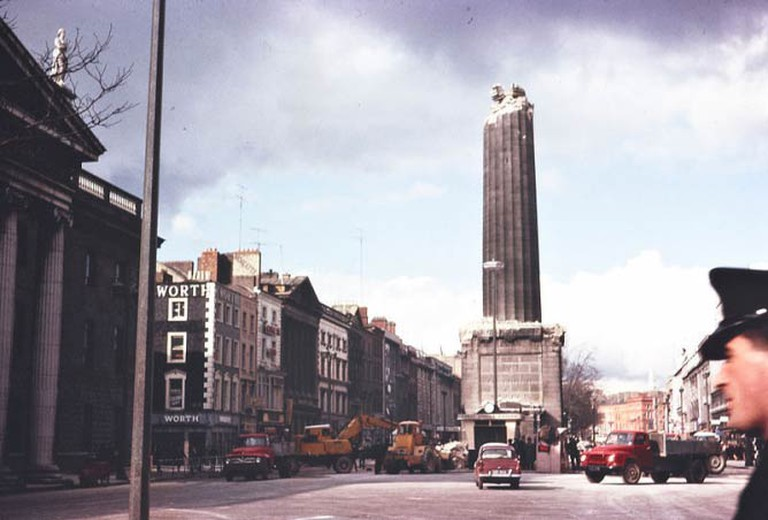 A half-demolished Nelson's Pillar on O'Connell Street, Dublin | © National Library of Ireland on The Commons/WikiCommons