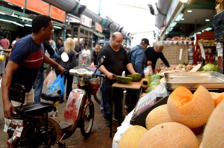 Seller at the HaTikva market Courtesy of Yael Tamar