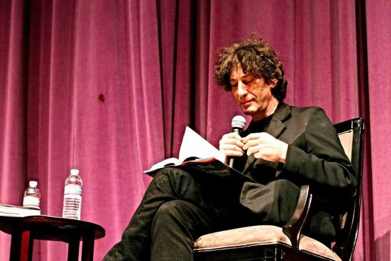 Neil Gaiman reading out one of his novels | © John Nakamura Remy/Flickr