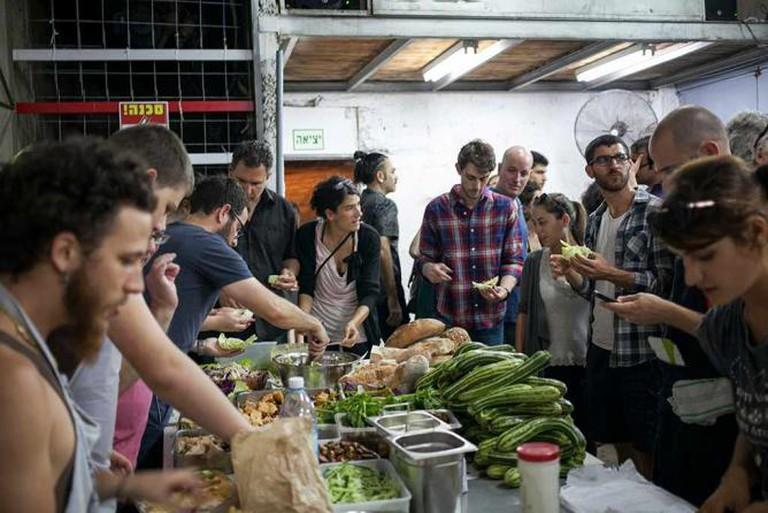 Tasting local foods at Disco Mekarer, courtesy of Anat Peiser