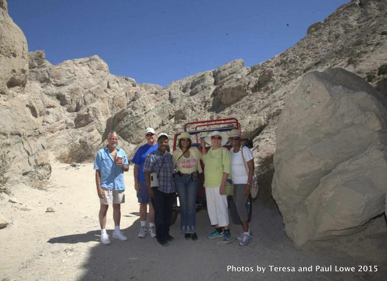 "A happy group enjoys a Desert Adventure Tour in the heart of the San Andreas Fault with eco tour guide Darrell Eismean ""Blackfeather""."