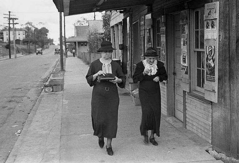 Two Women Walking Along a Street in Natchez