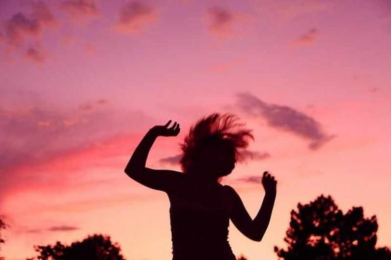 Sunset Party Dancing Girl Silhouette   © D. Sharon Pruitt/WikiMedia Commons