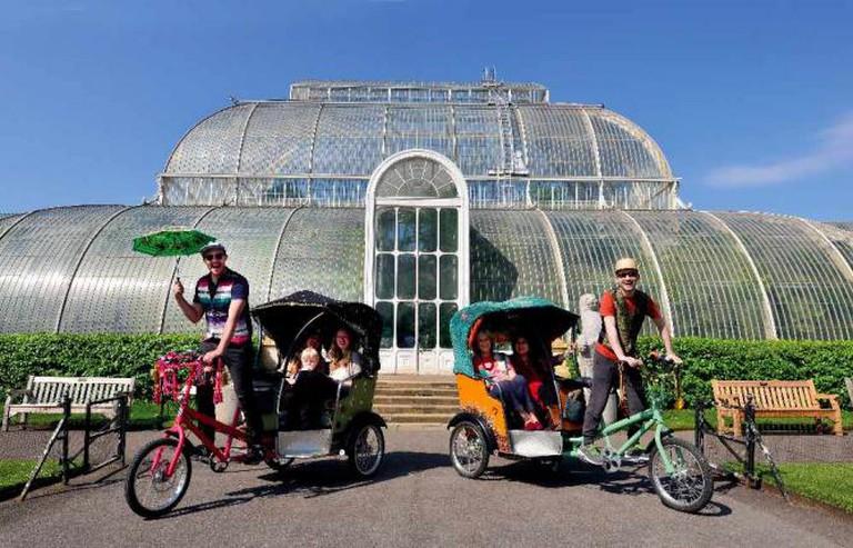 Rickshaws outside a botanic greenhouse