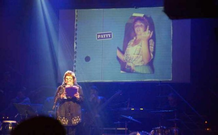 Performer with childhood photo at Mortified Live | Courtesy Mortified
