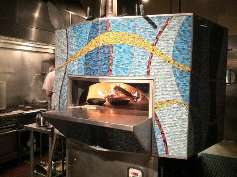 mosaic fronted stone hearth oven at The Golden Beetle