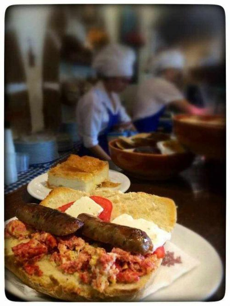 Typical Greek breakfast: Bread with feta cheese, tomato and sausage | Courtesy of Koukos