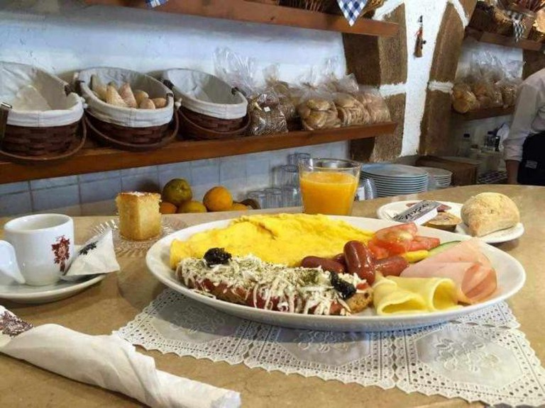 Breakfast with omelet, sausage, ham and cheese | Courtesy of Koukos