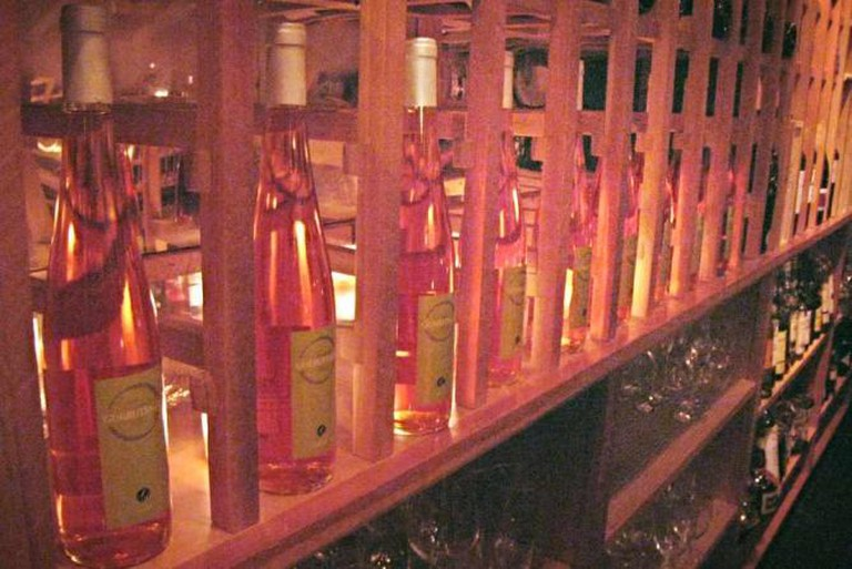 Bottles of Spanish Wine sit behind the bar at Tinto in Philadelphia