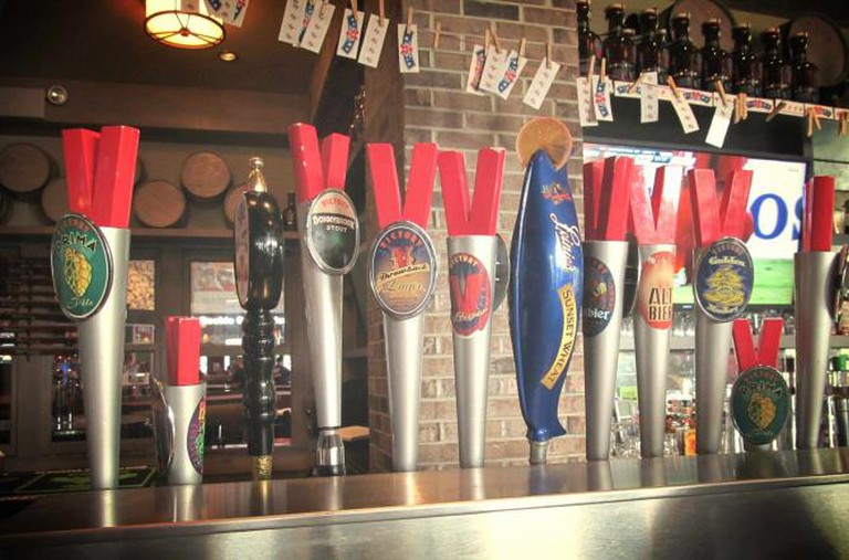 A row of Victory taps lines the bar at the Victory Brewing Company in Downingtown, PA.