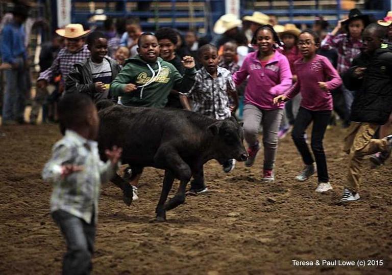Kids enjoy a version of running of the bulls | ©BillPicketRodeo