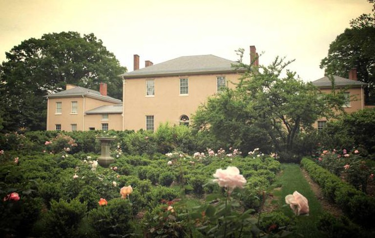A shot from behind Tudor Place in its flower garden.