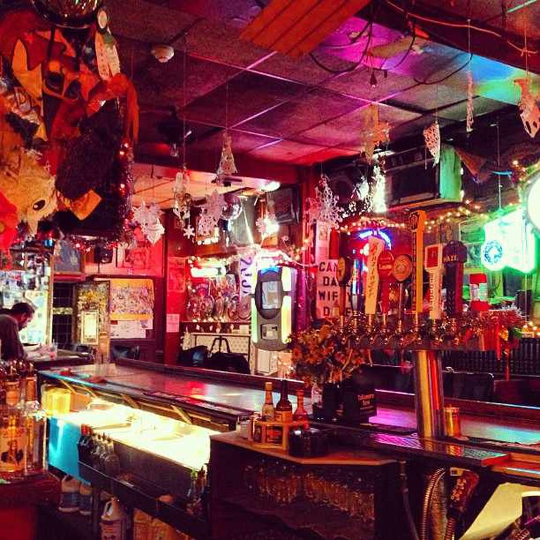 An interior view of the kitschy masks and snowflake decorations decorating Dirty Frank's located at 13th and Pine Streets.