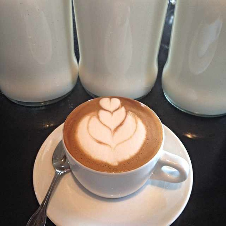 Home-made almond milk in coffee