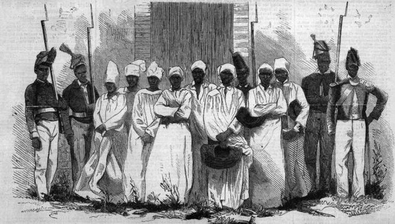 A sketch of the eight Haitian Vooodoo devotees found guilty in 1864 in the affaire de Bizoton. The theme of Voodoo and its use under Papa Doc's regime is discussed in The Comedians | © Wikicommons