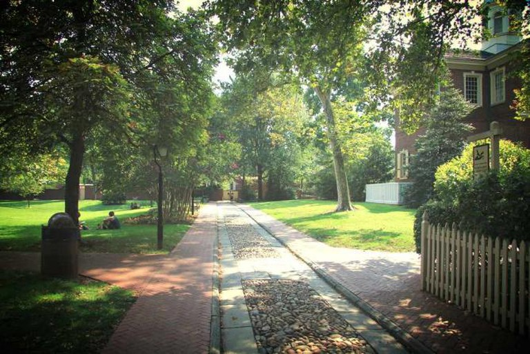 Carpenter's Hall walkway and green space is used for lounging space on a peaceful afternoons.