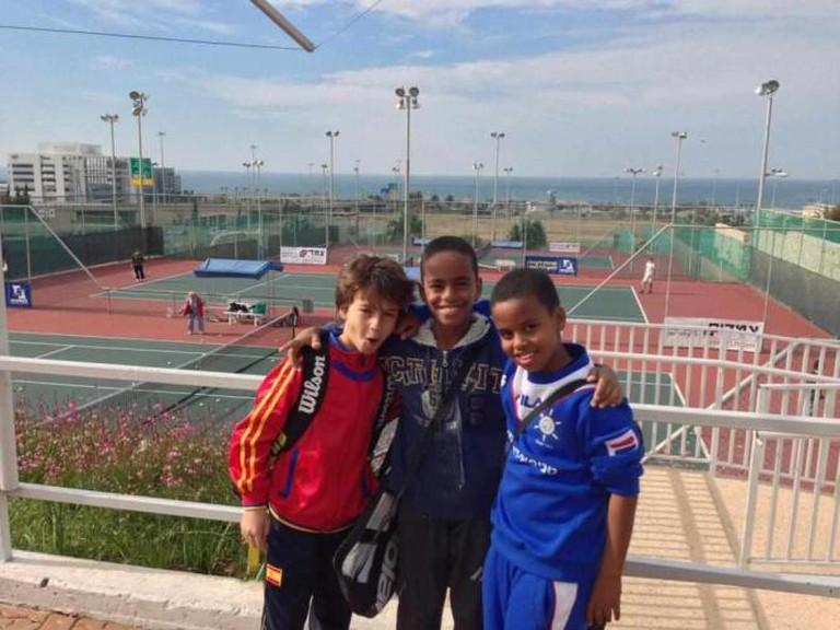 Three boys at the Selma and Irving Ettenberg Israel Tennis Center in Haifa   © Courtesy Israel Tennis Centers