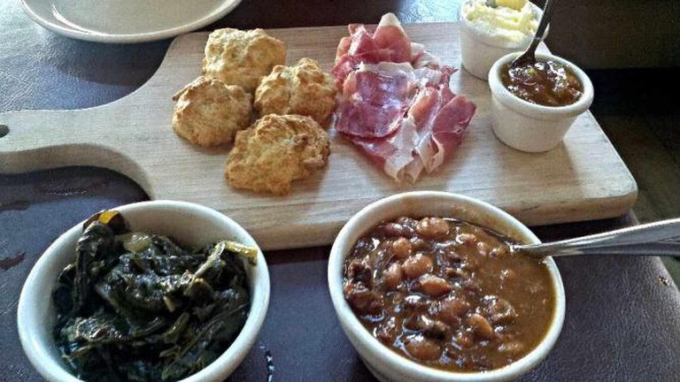 Collard greens, beans and other delicious sides sit add to a tasty Souther menu.