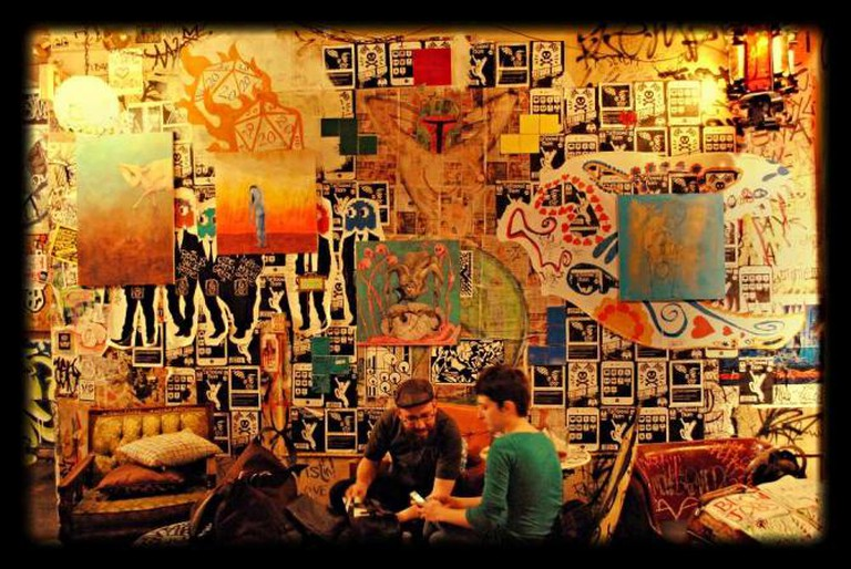 An view of the upstairs interior with its graffiti walls and scribbled-on antique chairs.