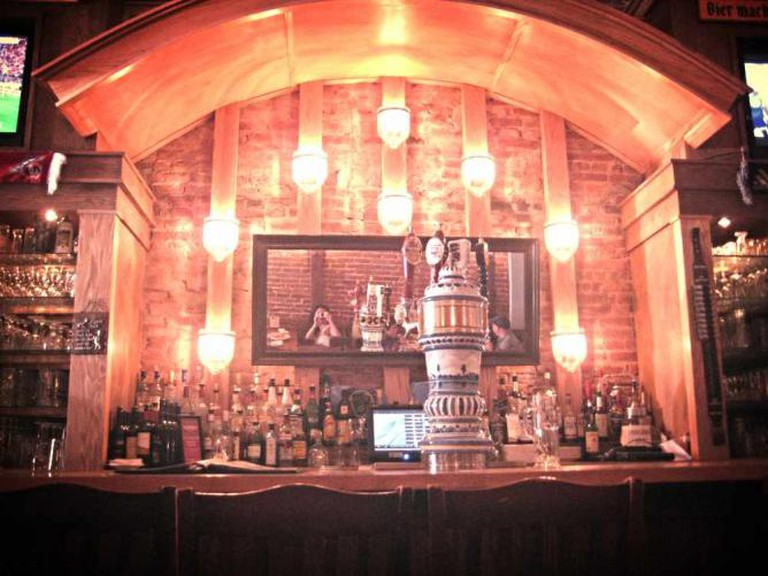 A view of the Brauhaus Schmitz bar with its ornate tap.
