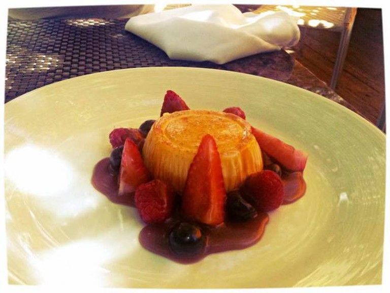 The beautiful Panna Cotta al Zafferano served on the spacious patio at Piccolo Sogno.