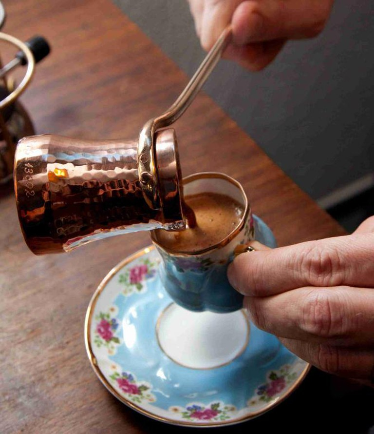 Middle-Eastern style coffee, poured from a copper cezve