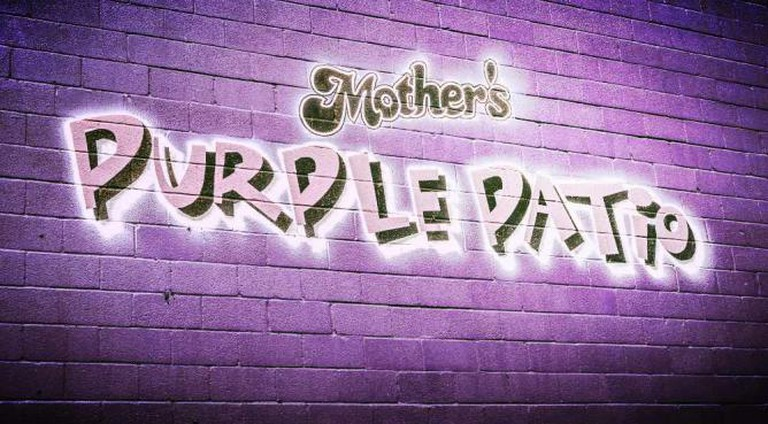The wall at Mother's famous purple patio where fans cheer on sports teams like the Ravens.