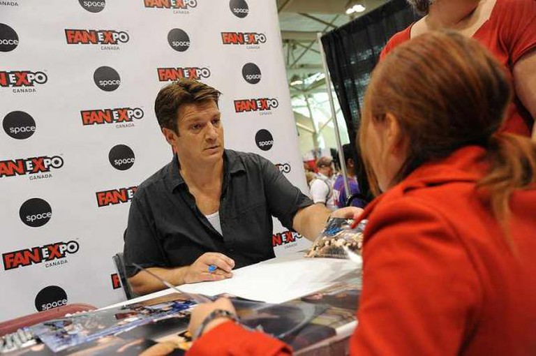 Nathan Fillion (Firefly) signing autographs   © mediatonicpr/Flickr