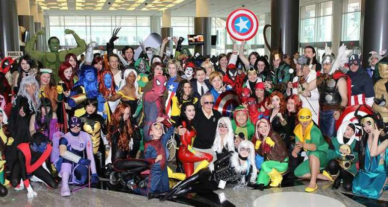 Stan Lee posing with cosplayers   © mediatonicpr/Flickr photo credit Billy Lazarou