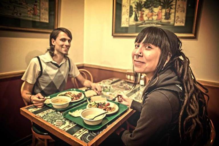 Two diners at Govinda's Vegetarian buffet in Denver.