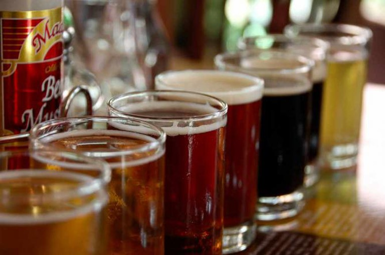 A photo of beers on the bar