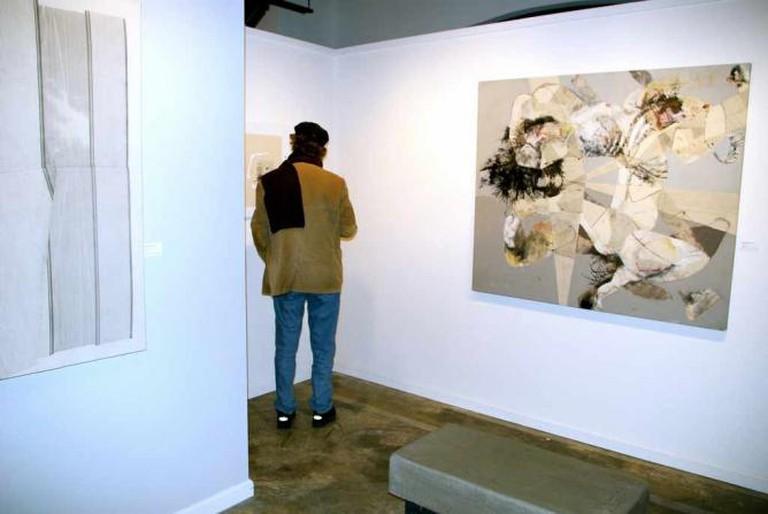 An art enthusiast at Bennett Galleries exhibit
