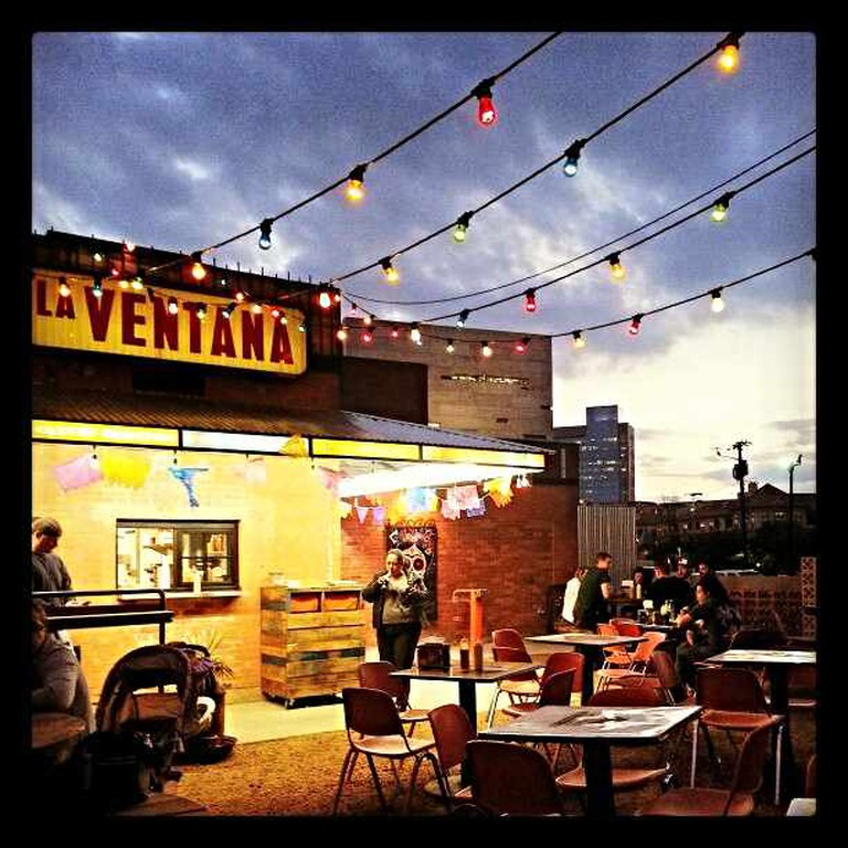 The outdoor patio with stringed overhead lighting at Taquaeria La Ventana in Downtown Dallas.