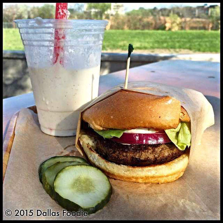 The burgers at Rodeo Goat in Dallas, Texas with a nice view of the park beside it.