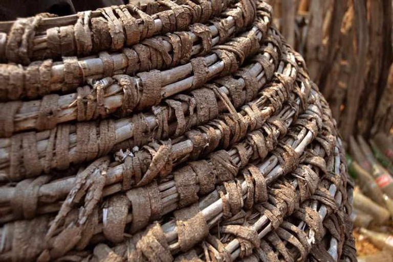Namibia — Weaving detail on sorghum storage huts in Northern Namibia | © Elao Martin