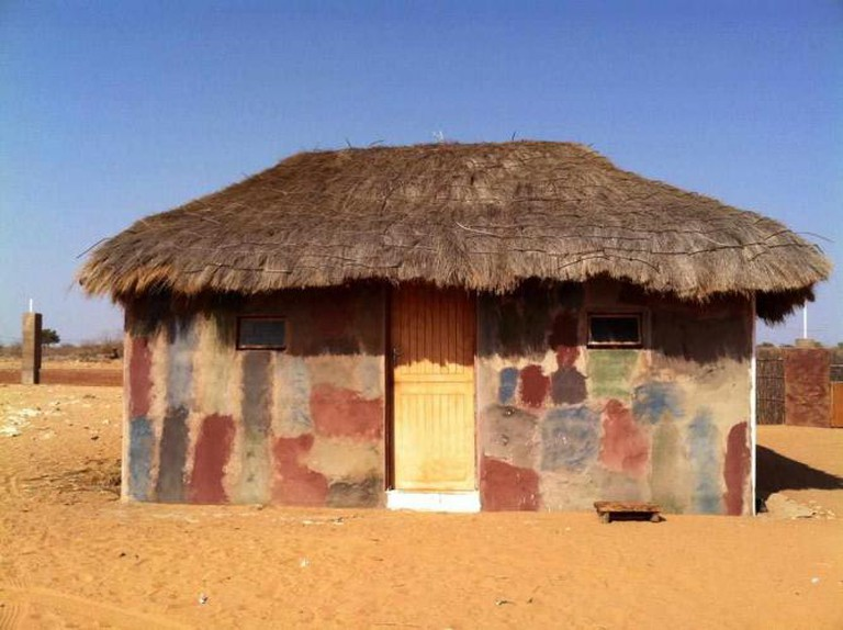 South Africa Tswana traditional kitchen wood and mud-dung construction with grass thatched roof | © Art Chambers