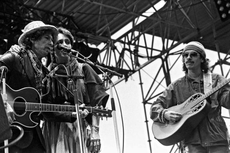 Bob Dylan, Joan Baez, and Carlos Santana in Hamburg, May 1984 | © Heinrich Klaffs