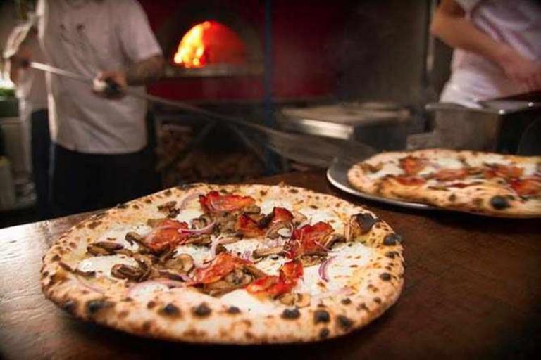 Speckenwolf Pizza: Mozzarella, Speck, Mushrooms, Onion, Oregano | Courtesy of Anthony Falco