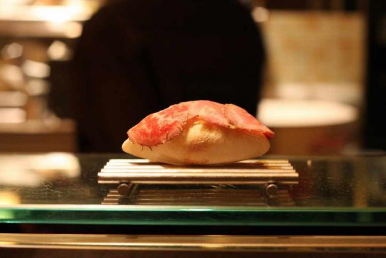 One of the idiosyncratic dishes at minibar consists of meat placed over a rock.